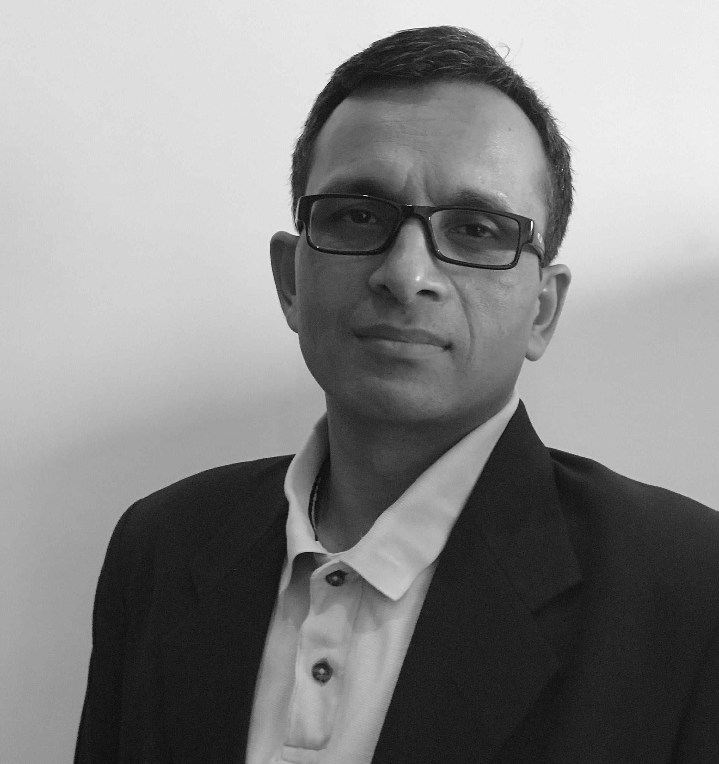 Black and white headshot of Anuraag Guptaa